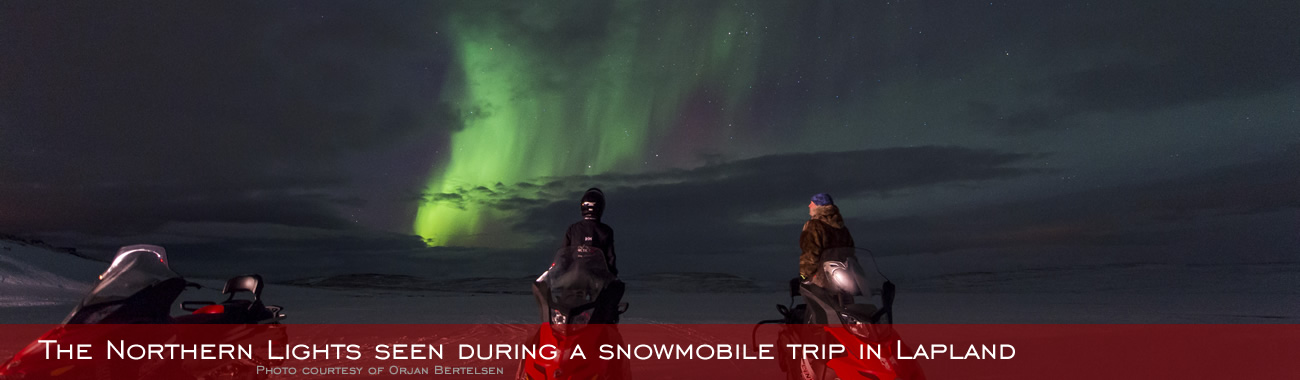 The Northern Lights seen during a snowmobile trip in Lapland