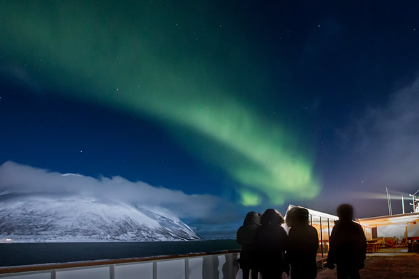 Northern Lights viewed from the deck of one of Hurtigruten's ships.